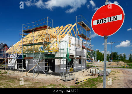 Private Housebuilding And Costs Warning Sign - Stock Photo