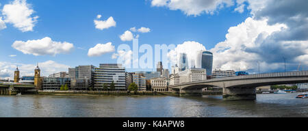 Panoramic view of City of London skyline: River Thames at London Bridge, the Walkie Talkie, Cheesegrater, Adelaide - Stock Photo
