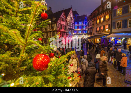 Colorful lights on Christmas trees and ornaments at dusk Colmar Haut-Rhin department Alsace France Europe - Stock Photo