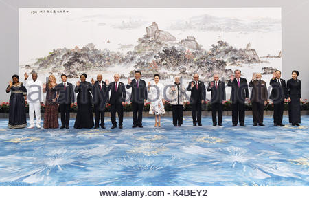 Chinese President Xi Jinping and his wife Peng Liyuan pose for a group photo with leaders attending the 9th BRICS - Stock Photo