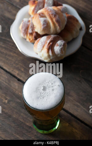 Beer glass on a wooden table, from above - Stock Photo