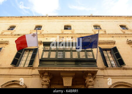 Maltese And European Flag In Valletta - Stock Photo