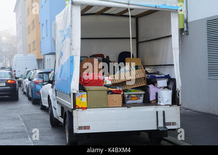 In A Delivery Van Is Granted At The Change Of Residence - Stock Photo