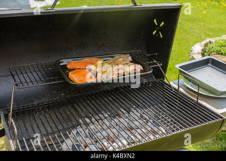 Deliciously Seasoned Meat Is Grilled At The Charcoal Grill - Stock Photo