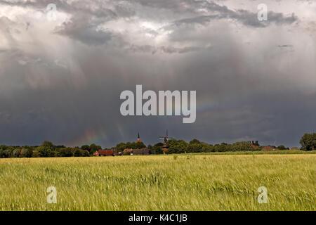Rainbow Over East Frisia, Germany - Stock Photo