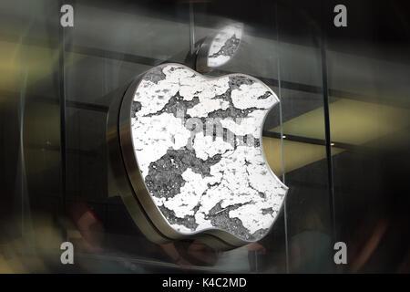 Eroding Apple Sign - Stock Photo