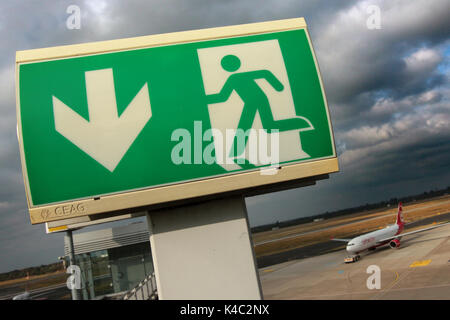 Emergency Exit Sign With Airbus A320 Of Airberlin At Duesseldorf Airport - Stock Photo
