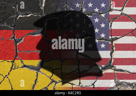 Silhouette Of Donald Trump With Flags Of Usa And Germany On Eroding Ground - Stock Photo