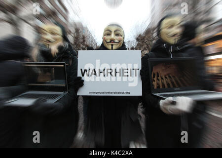 Anonymous Activists Wearing Guy Fawkes Masks Holding A Sign Truth - Stock Photo