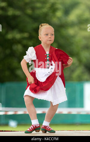 Aberlour, Scotland, UK. 05 Aug, 2017: Young dancer performing the Irish Jig during the 2017 Highland Games in Aberlour, - Stock Photo