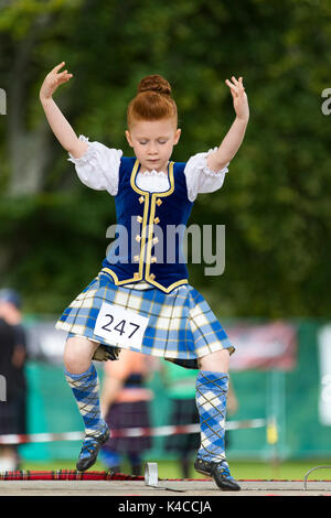 Aberlour, Scotland, UK. 05 Aug, 2017: Young competitors performing the Sword Dance during the 2017 Highland Games - Stock Photo