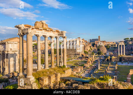 Rome Italy The columns of the Temple of Saturn and overview of the ruined Roman Forum, UNESCO World Heritage Site, - Stock Photo