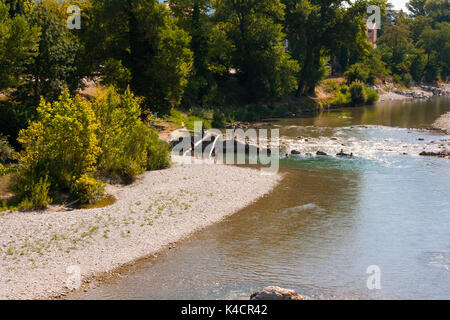 A view of the Drome River in the South East of France at the height of summer when the river is at a low and shale - Stock Photo