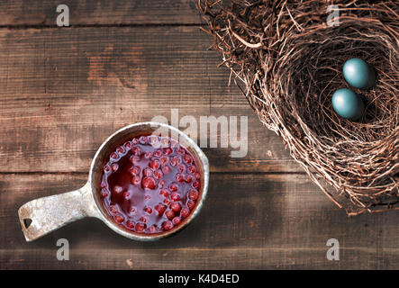 Lingonberry Drink and Bird Eggs - Stock Photo