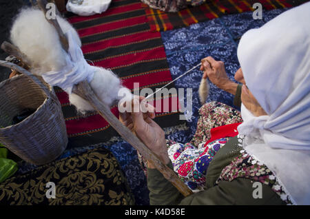 old woman; How to make rope - Stock Photo