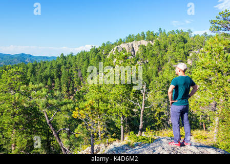 Tourist looking at the landscape in Custer State Park in South Dakota - Stock Photo