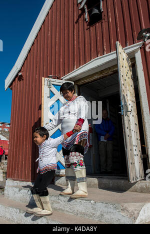 Greenland, Scoresbysund aka Scoresby Sund. Remote settlement of Ittoqqortoormiit, local woman and child in traditional - Stock Photo
