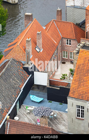 Typical old houses with inner yards and balconies in the center of Bruges, Belgium. - Stock Photo