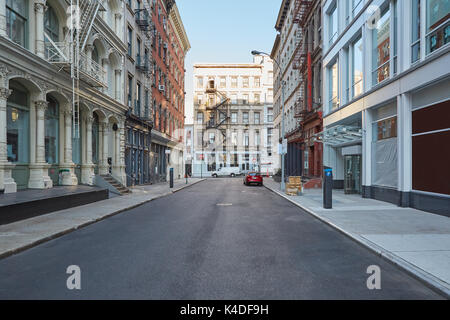 Soho empty street with cast iron buildings in a sunny day in New York - Stock Photo