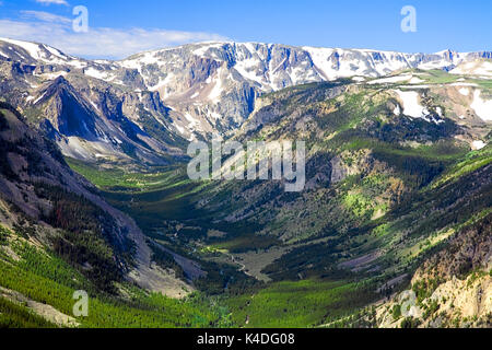 View from Beartooth Pass, Montana.  The Beartooth Highway is an All-American Road on a section of U.S. Route 212 - Stock Photo