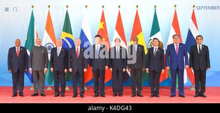 Leaders attending the BRICS Summit meeting on the Dialogue of Emerging Market and Developing Countries stand together - Stock Photo