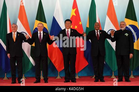 Leaders attending the BRICS Summit stand together for a family photo September 5, 2017 in Xiamen, China. Left to - Stock Photo