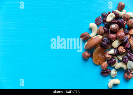 Healthy quick snack in office. Dry fruits and nuts on desk - Stock Photo