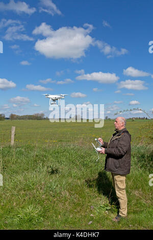 man flying drone near Teschendorf, Brandenburg, Germany - Stock Photo