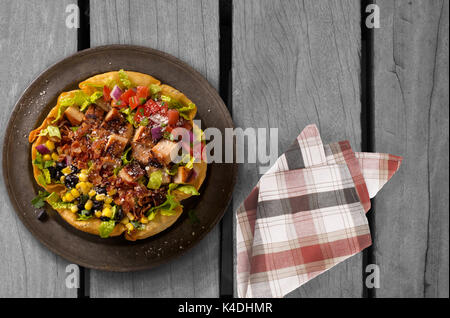 Taco salad on wooden table - Stock Photo