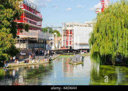 Regents Canal flows through Camden Lock in the heart of Camden Town in London, UK. - Stock Photo