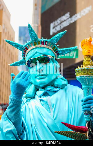 New York, USA - September 27, 2016: Street Performer dressed as the statue of liberty available for tourist photographs - Stock Photo