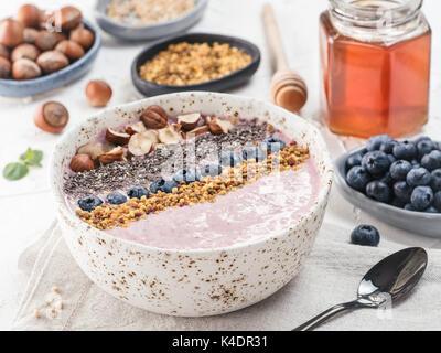 Healthy breakfast. Buckwheat Porridge. Raw buckwheat vegan breakfast smoothie bowl with fresh blueberries, nuts, - Stock Photo