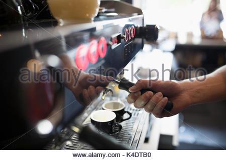 Close up barista using, making espresso machine in cafe - Stock Photo
