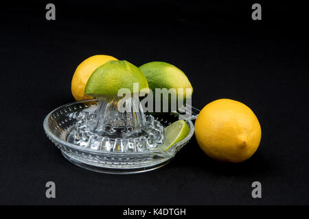 Juicer and citrus fruits. - Stock Photo
