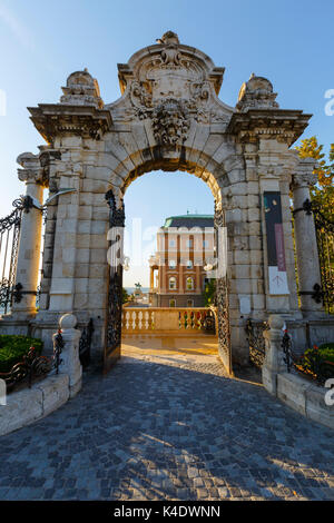 Morning view of Buda castle through a gate of the complex. - Stock Photo