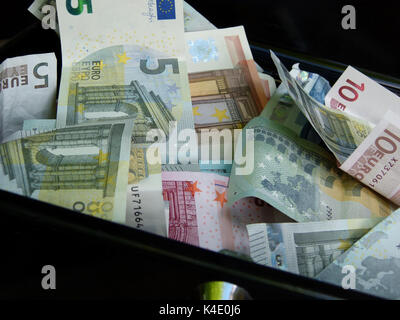 Symbol For Black Money. Euro Banknotes In A Cash Box - Stock Photo