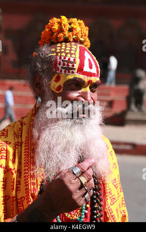 Closeup portrait of monk - sadhu in the square in Kathmandu. Patan, Durbar Square, Nepal - Stock Photo