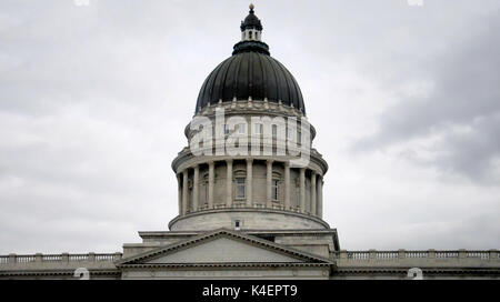 The dome of the utah state capitol building on a gray sky. - Stock Photo
