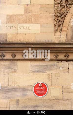Peterloo Massacre red plaque on the Free Trade Hall building in Manchester which is now the Radisson Hotel - Stock Photo