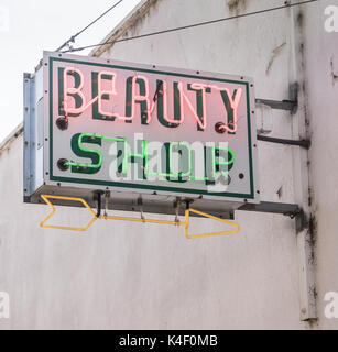 The beauty palor is closed but the neaon sign is on - Stock Photo