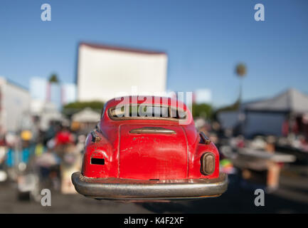Rear end of old vintage classic metal toy car at swap meet  drive in. This car was found while treasure hunting - Stock Photo