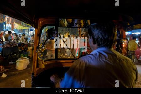 NEW DELHI, INDIA - CIRCA OCTOBER 2016: Tuk Tuk driver in the streets of  Chandni Chowk in Old Delhi. - Stock Photo