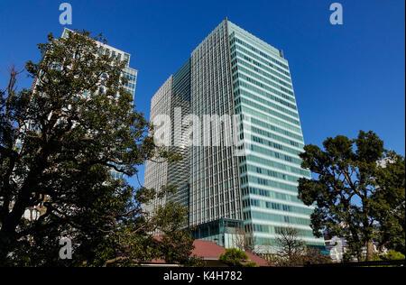 Tokyo, Japan - Jan 3, 2016. Office buildings in Tokyo, Japan. Tokyo is a major international finance center, houses - Stock Photo