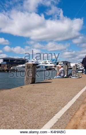Man fishing from Poole Quay, Dorset, England - Stock Photo