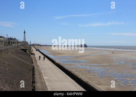 Blackpool North Shore, beach and promenade looking south to the North Pier and the famous Blackpool Tower. - Stock Photo