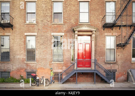 Typical New York City Apartment Building With Fire Escapes On The