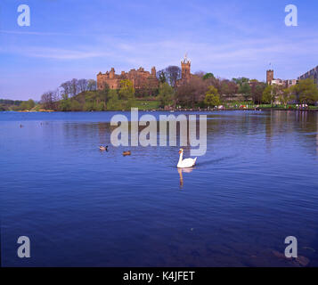 A peaceful spring view across Linlithgow Loch towards Linlithgow Palace, Midlothian, Scotland - Stock Photo