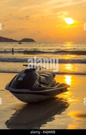 Jet ski at sunset on Patong beach, Phuket, Thailand - Stock Photo