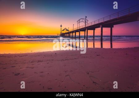 Brighton Beach jetty silhoutte at sunset, South Australia - Stock Photo