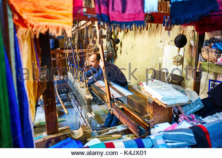 Weaving silk shawls in the Medina of Fez, Morocco, North Africa, Africa - Stock Photo
